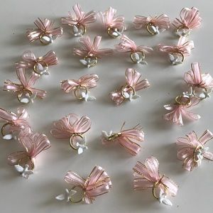 Small pink wedding bows with ring and dove.